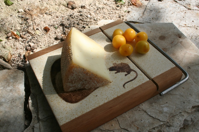 Artisan cheese and plums