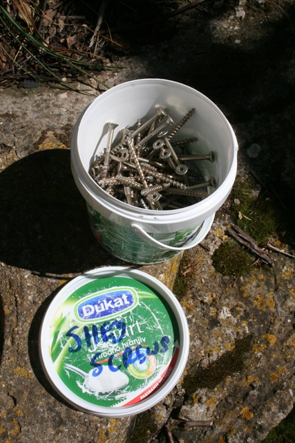 Shed screws in their container